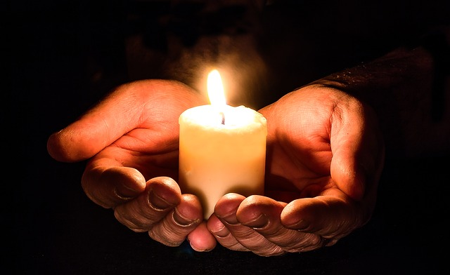 Photo of hands holding a candle by Myriams-Photos, via Pixabay (no attribution required). Accessed 16 Oct. 2018.